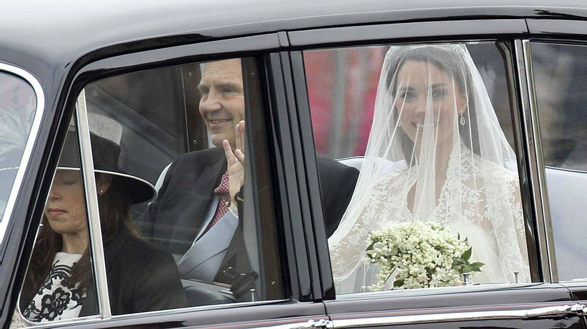 Catherine Middleton and her father Michael Middleton travel past Buckingham Palace as they make their way to the Royal Wedding of Prince William to Catherine Middleton at Westminster Abbey on April 29, 2011 in London, England.