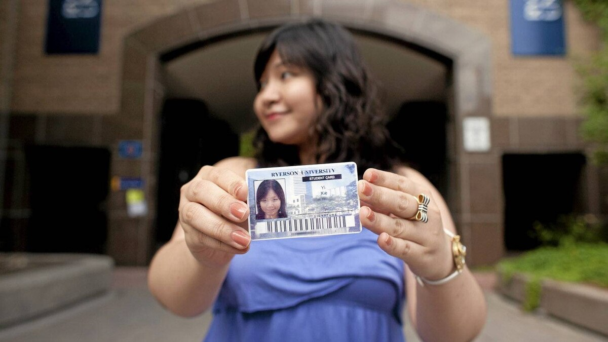 Sheery Xie poses for a photo with here expired Ryerson Student card, at Ryerson University, in Toronto, Friday, August 5, 2011. Xei uses her student card to get discounts on services like Greyhound