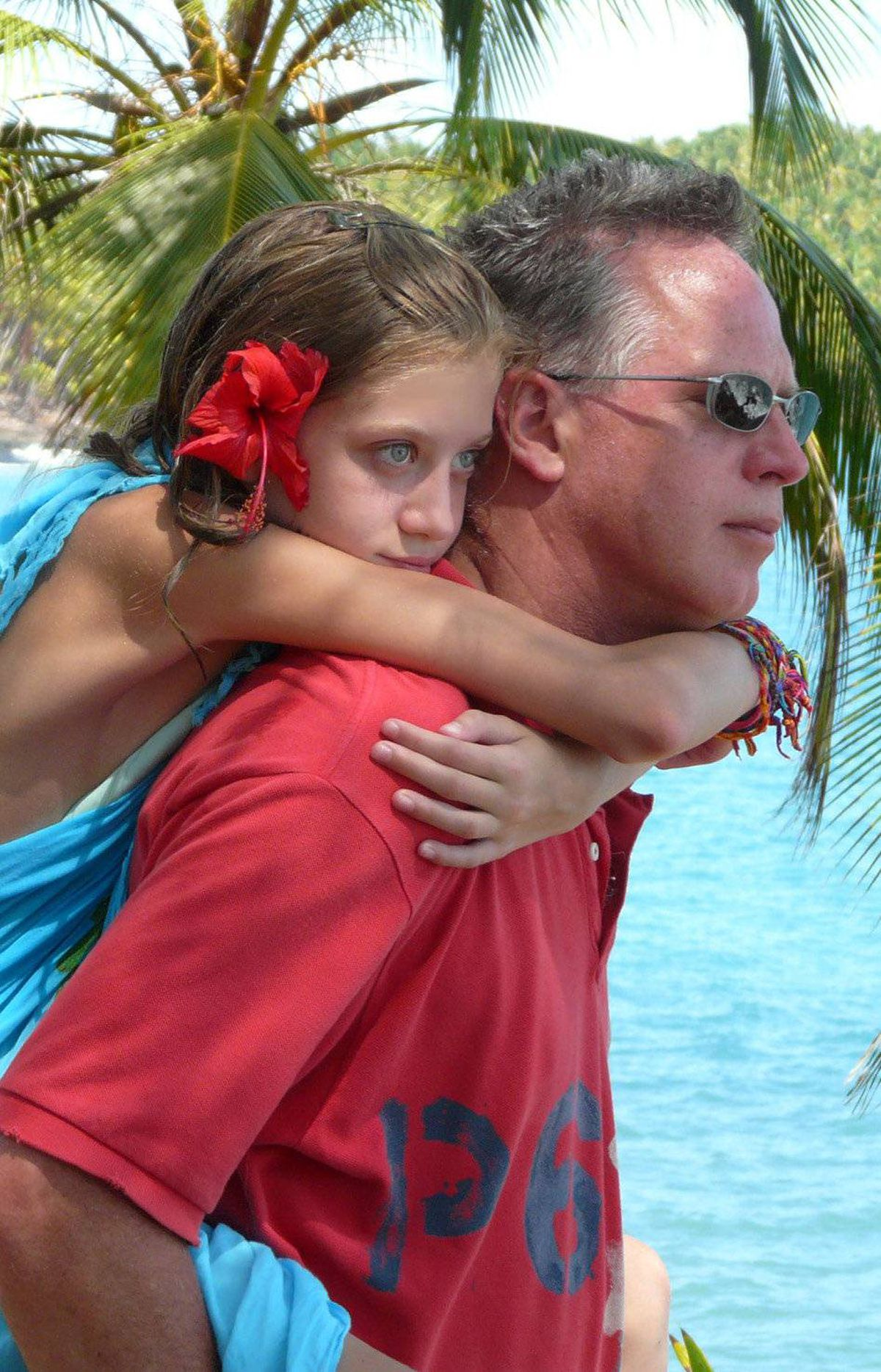 On Devil's Island, off the coast of South America, the temperature was about 40 degress and the humidity was about 85%. Dad was really hot and tired, but he picked up our daughter and carried her.