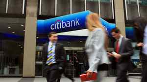 People walk by a Citibank office in midtown Manhattan on April 19, 2010 in New York City.