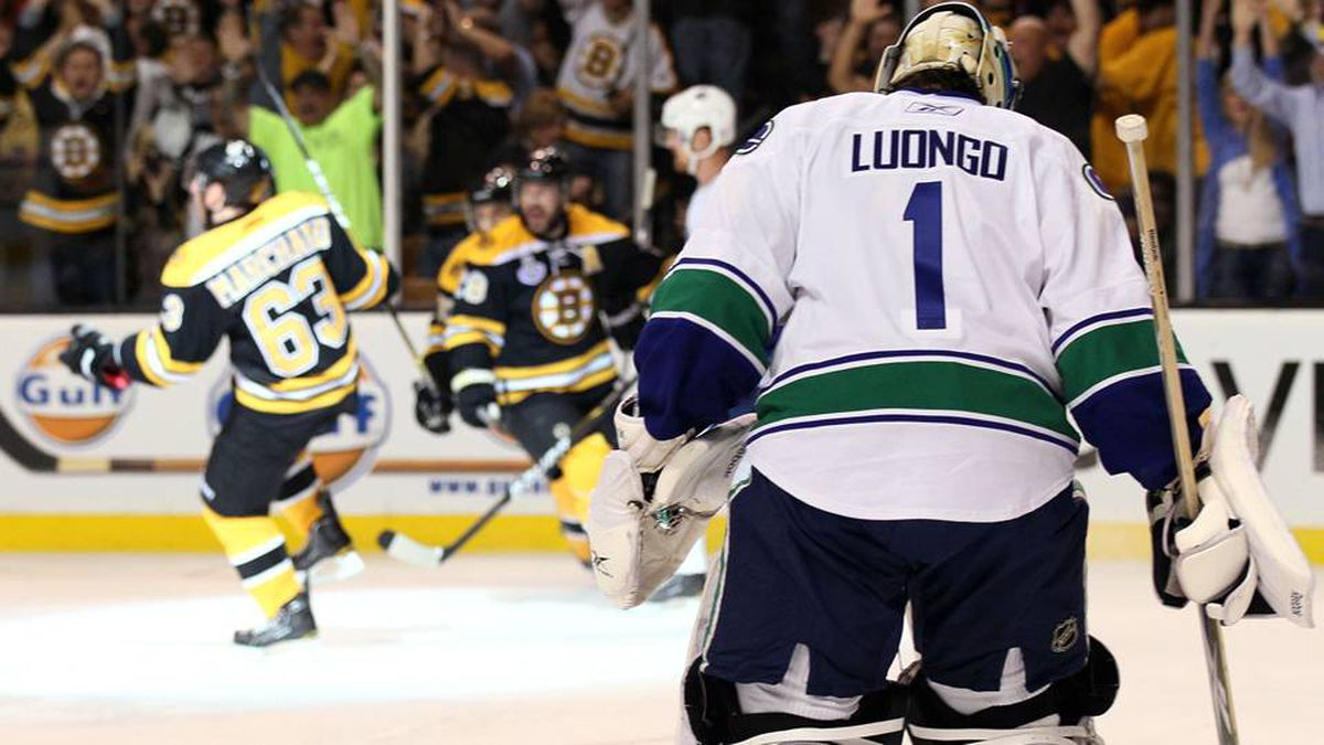 Brad Marchand of the Boston Bruins celebrates after scoring a goal in the first period as Roberto Luongo of the Vancouver Canucks looks on during Game 6.