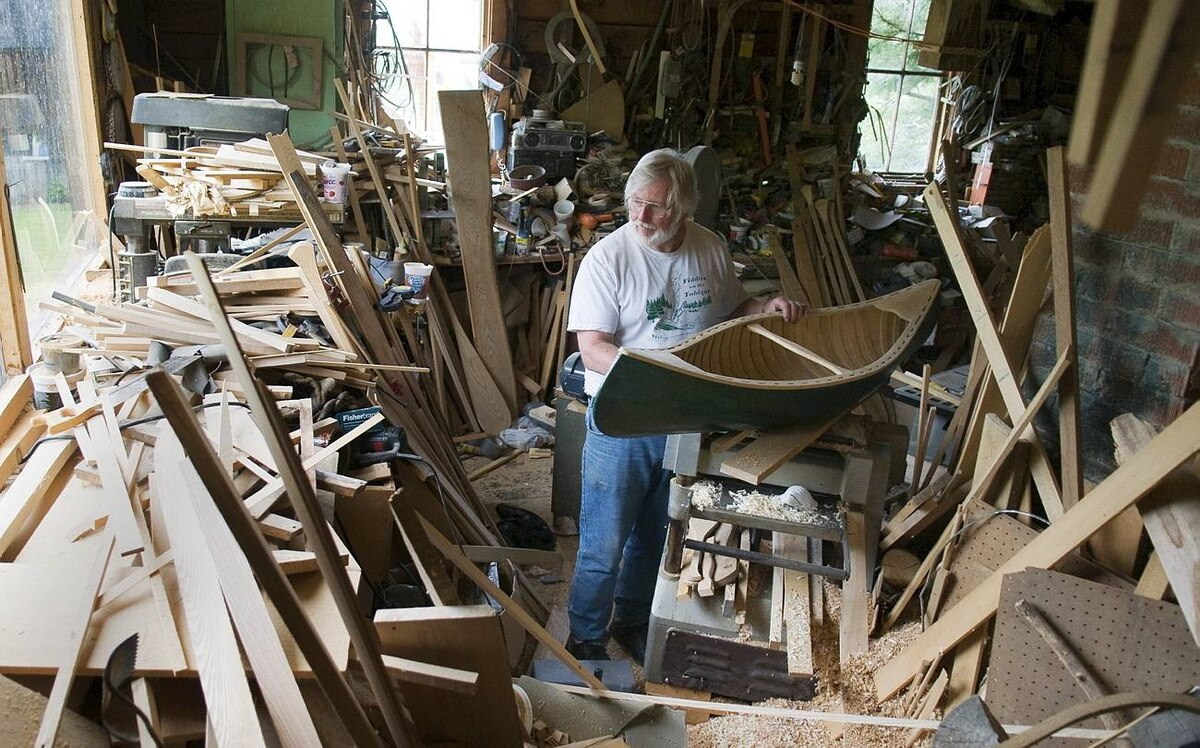 Bill Miller pauses for a moment in his cluttered workshop and peers out the window.