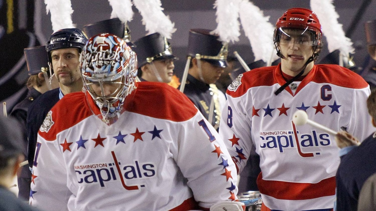 Washington Capitals' Semyon Varlamov (1) and Alex Ovechkin enter the NHL Winter Classic outdoor hockey game against the Pittsburgh Penguins in Pittsburgh on Saturday, Jan. 1, 2011. (AP Photo/Keith Srakocic)