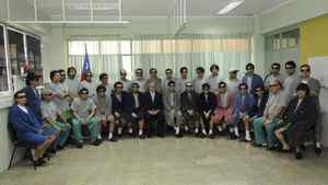 Chilean President Sebastian Pinera poses with the 33 rescued miners inside the Copiapo Hospital where they are undergoing full medical exams, in Copiapo October 14, 2010.