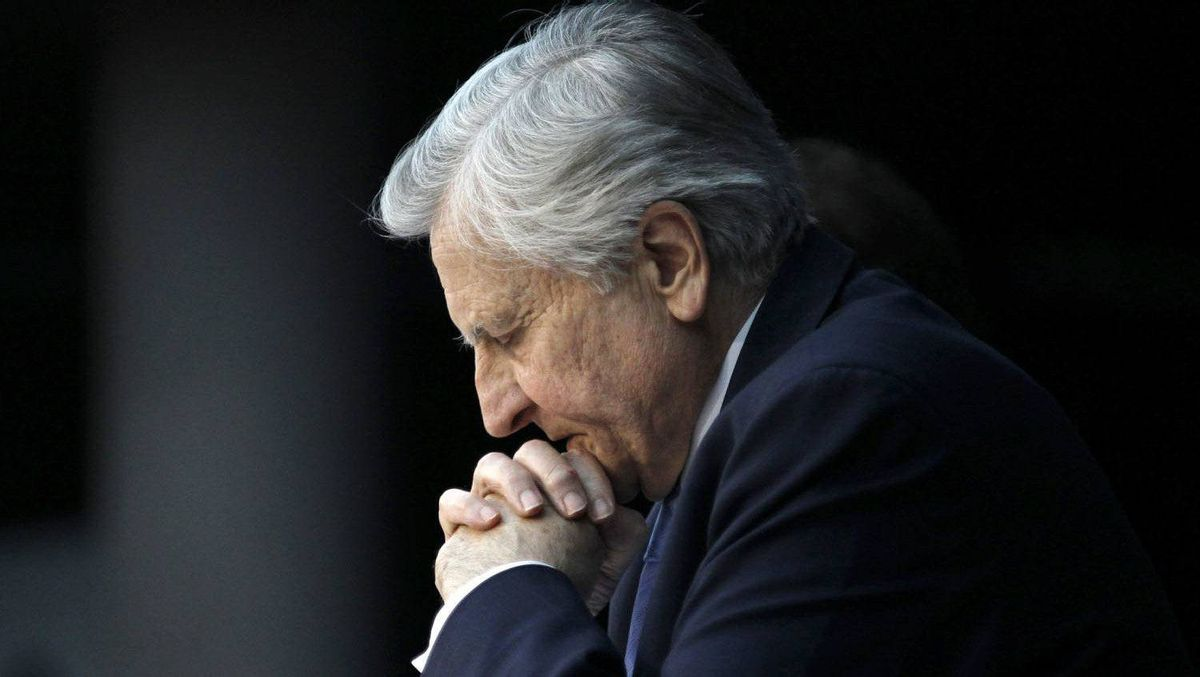 Jean-Claude Trichet, President of the European Central Bank (ECB) folds his hands as he listens to reporter's questions during his monthly news conference at the ECB headquarters in Frankfurt, February 3, 2011.