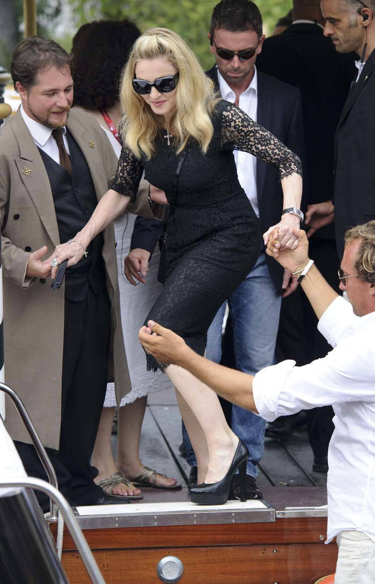 Ever wonder how many men it takes to get Madonna into an Italian speedboat? Me neither.