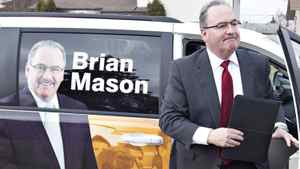 NDP Leader Brian Mason makes his way to a residential home to make his platform announcement in Edmonton March 28, 2012, for the upcoming Alberta provincial election.