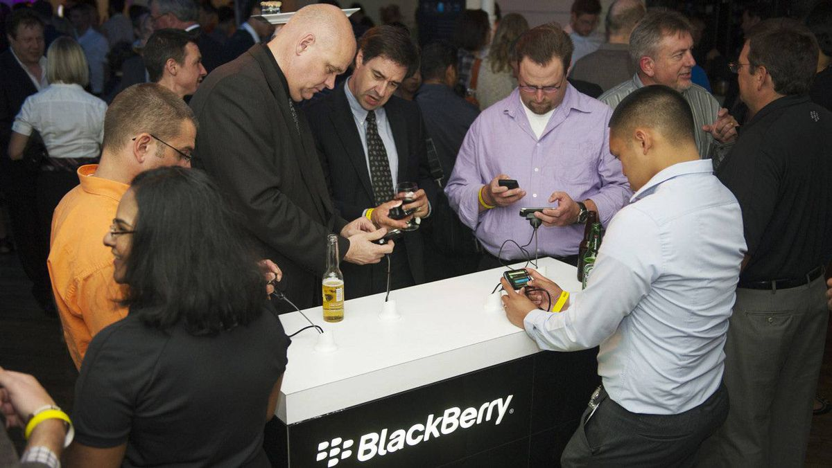 People look at new Blackberry devices at a release party to promote the BlackBerry OS 7 devices in Toronto Aug. 3, 2011.