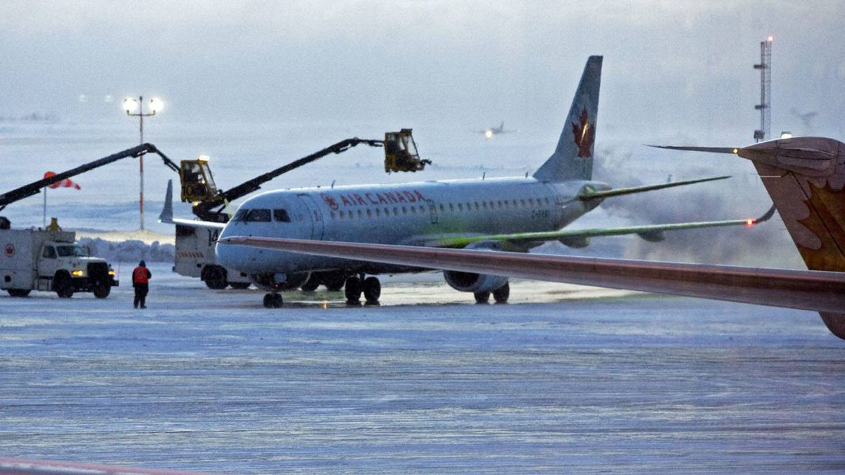 An Air Canada aircraft is de-iced on the tarmac at the airport in Halifax on Wednesday, Feb. 9, 2011.
