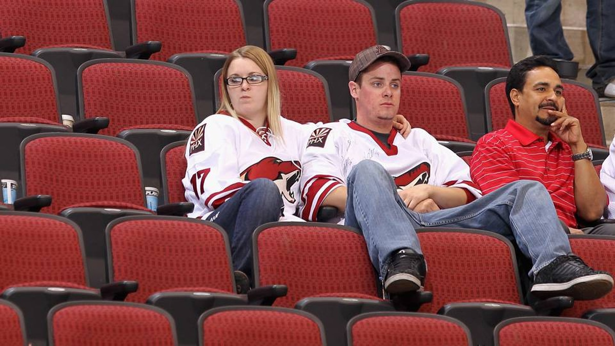 Fans of the Phoenix Coyotes react after being defeated by the Detroit Red Wings in Game 7 of the Western Conference Quarter-finals.