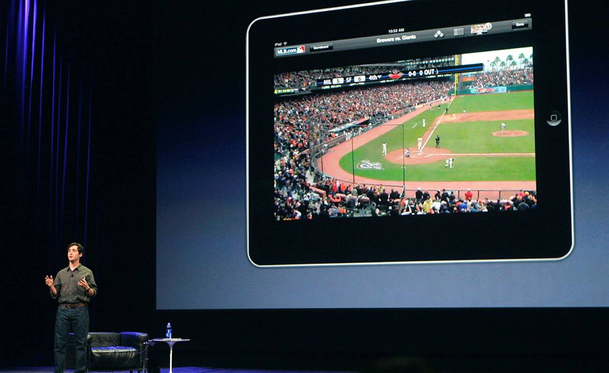 "Chad Evans from MLB.com discusses new ""iPad"" during the launch of Apple's new tablet computing device in San Francisco"