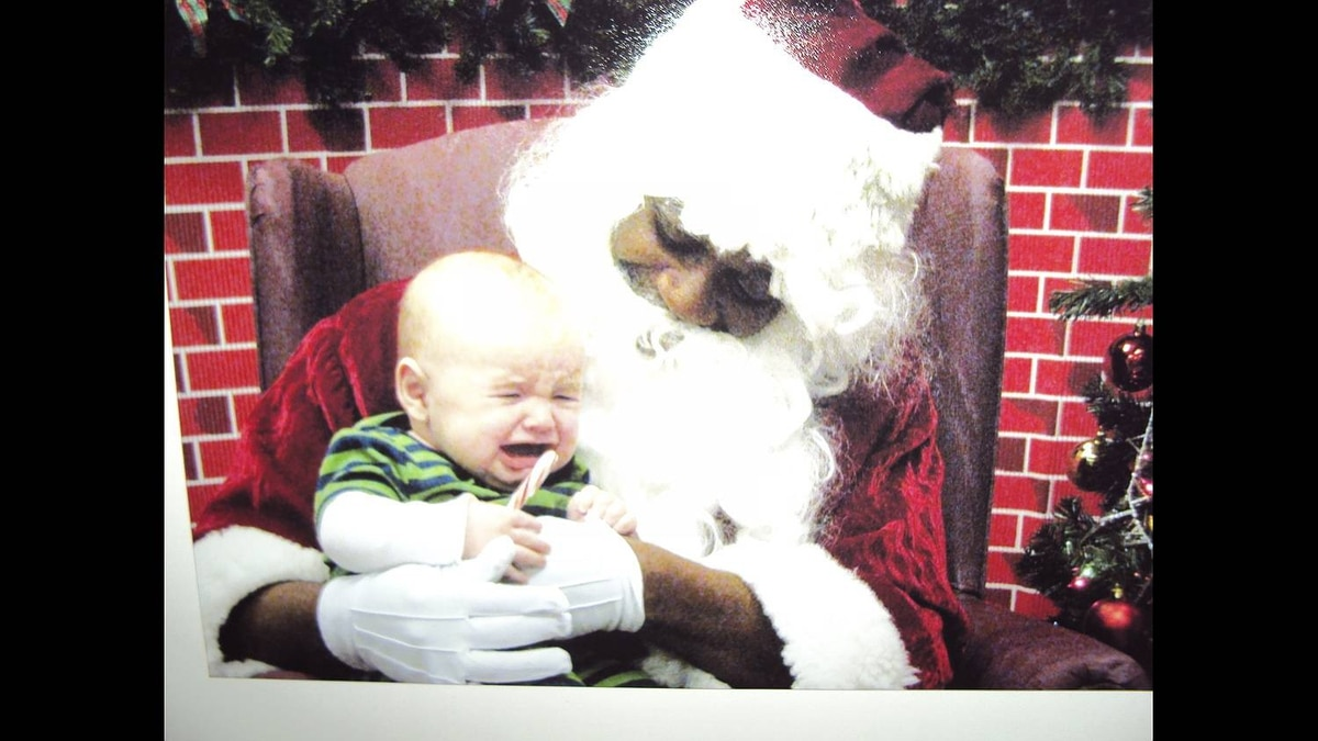 Somer Torres photo: Sad First Santa Visit - This is Miles' first Santa picture. He was all smiles when he was plopped on Santa's lap and given a candy cane. Then he looked up and realized his situation and let out a big sad scream.
