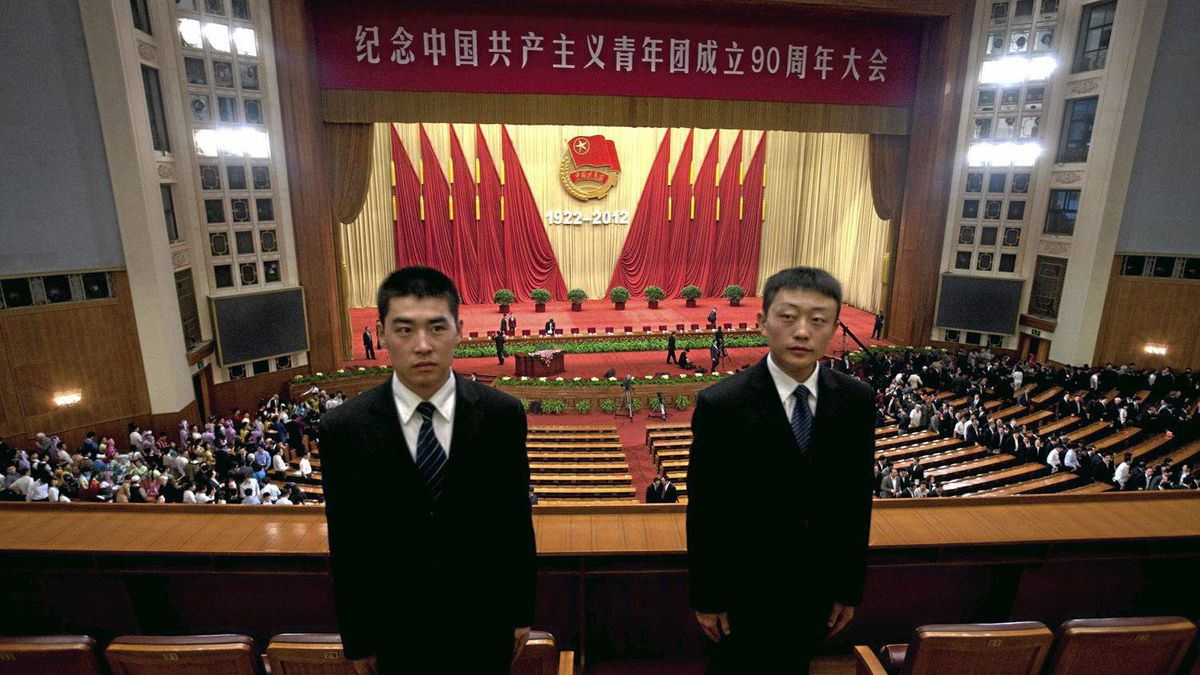 Two Chinese soldiers dressed as ushers stand guard while members of Communist Youth League leave a conference to celebrate the 90th anniversary of the founding of Chinese Communist Youth League at the Great Hall of the People in Beijing Friday, May 4, 2012. ()