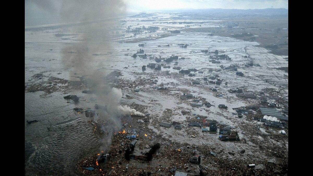 Fires burn in a harbour following an earthquake and tsunami in Natori City, Miyagi Prefecture