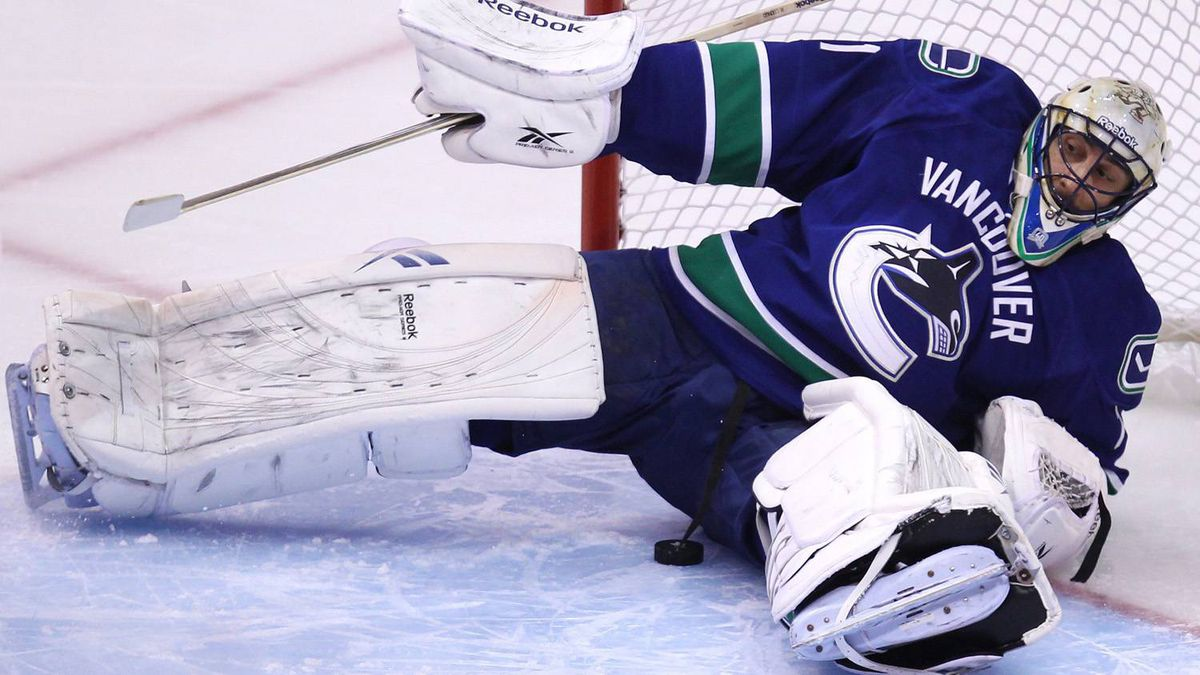 Vancouver Canucks' goaltender Roberto Luongo make a save. THE CANADIAN PRESS/Jonathan Hayward