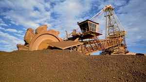 A loader prepares to shovel iron ore dug from an Australian mine in this undated handout picture from Port Hedland. BHP Billiton and other Australian miners sell hundreds of millions of tonnes of ore annually to steel mills worldwide. This year China's steelmakers want a big discount to compensate for weaker steel sales at home.
