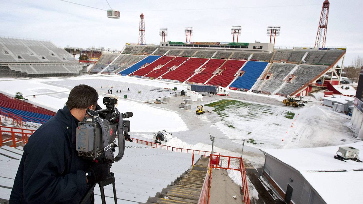A cameraman films the installation of the ice surface in preparation for the NHL Heritage Classic in Calgary, Alta., Thursday, Feb. 10, 2011. The Calgary Flames will play the Montreal Canadiens on Feb. 20 in the second NHL outdoor game of the 2010/2011 season.