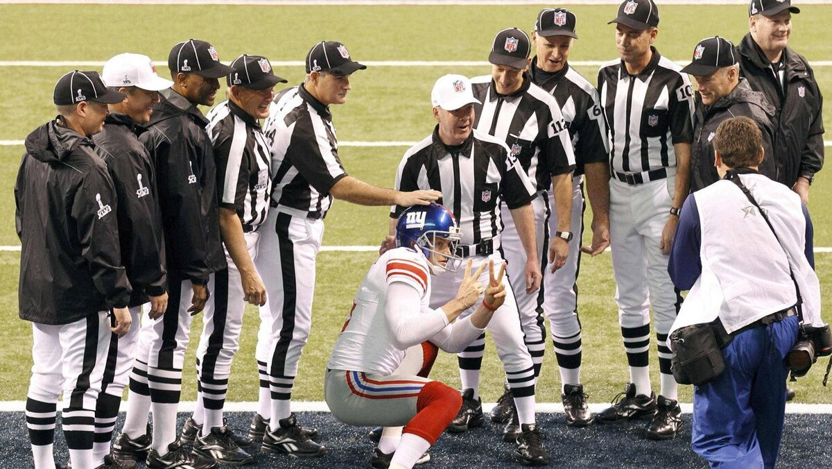 New York Giants punter Steve Weatherford sneaks into the referees' team picture prior to the start of the NFL Super Bowl XLVI football game against the New England Patriots in Indianapolis, Indiana, February 5, 2012. REUTERS/Pierre Ducharme