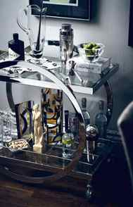 RAISE THE BAR Prohibition in the United States drove the party home, making the bar cart a must-have for stylish hosts. Kit yours out with statement-making accessories rendered in chrome and etched crystal.