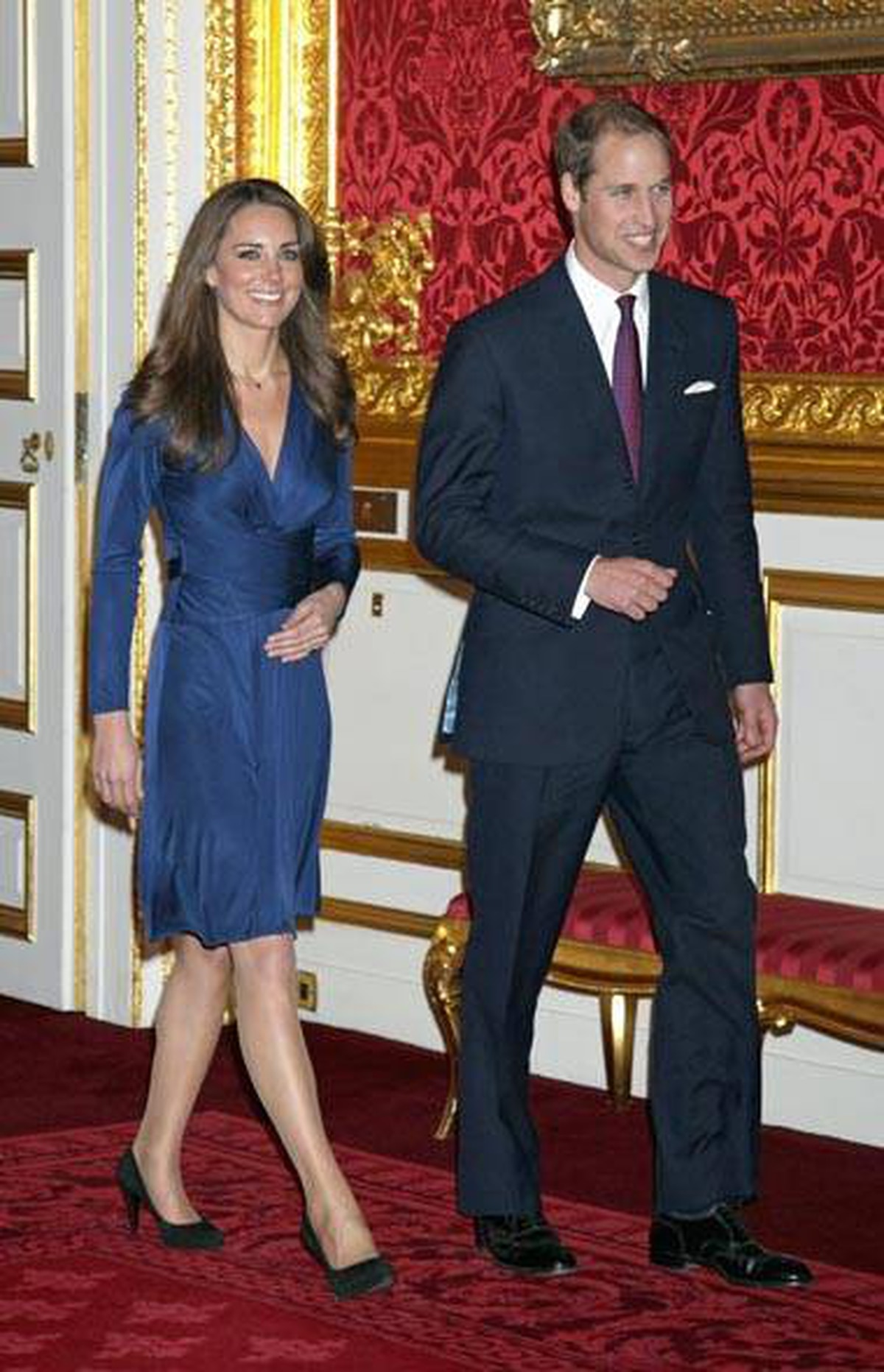 Way to colour co-ordinate, Kate. For the engagement announcement, she sported another body-conscious dress, this time in slinky sapphire. Perhaps to match her new bling?