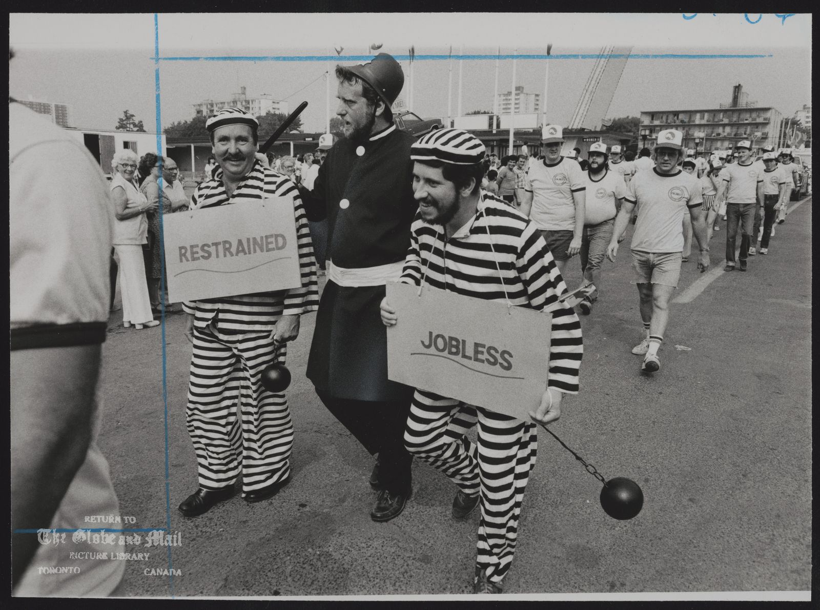 The notes transcribed from the back of this photograph are as follows: CANADIAN NATIONAL EXHIBITION Labour Day Parade Jack Sullivan, left, Gord Gerrard, middle, and Danny Ginn lead members of Ontario Liquor Board Employees Union.