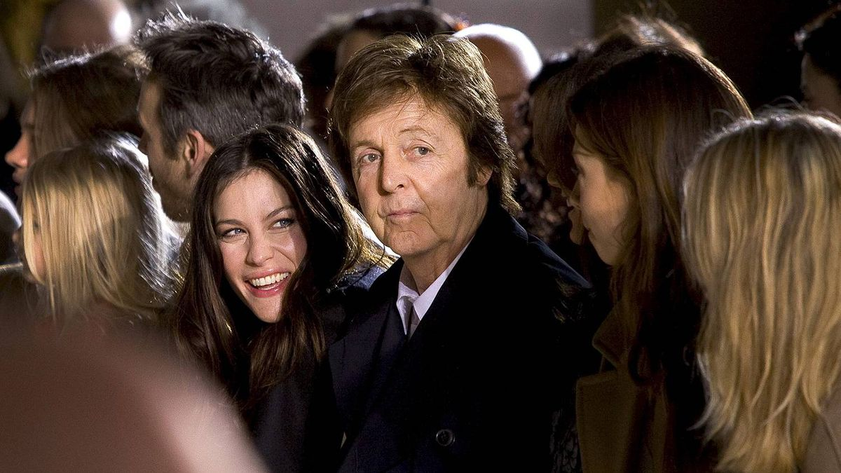Paul McCartney and actress Liv Tyler, left, watch the show from designer Stella McCartney as part of her Fall-Winter, ready-to-wear 2012 fashion collection, during Paris Fashion week, Monday, March 7, 2011.
