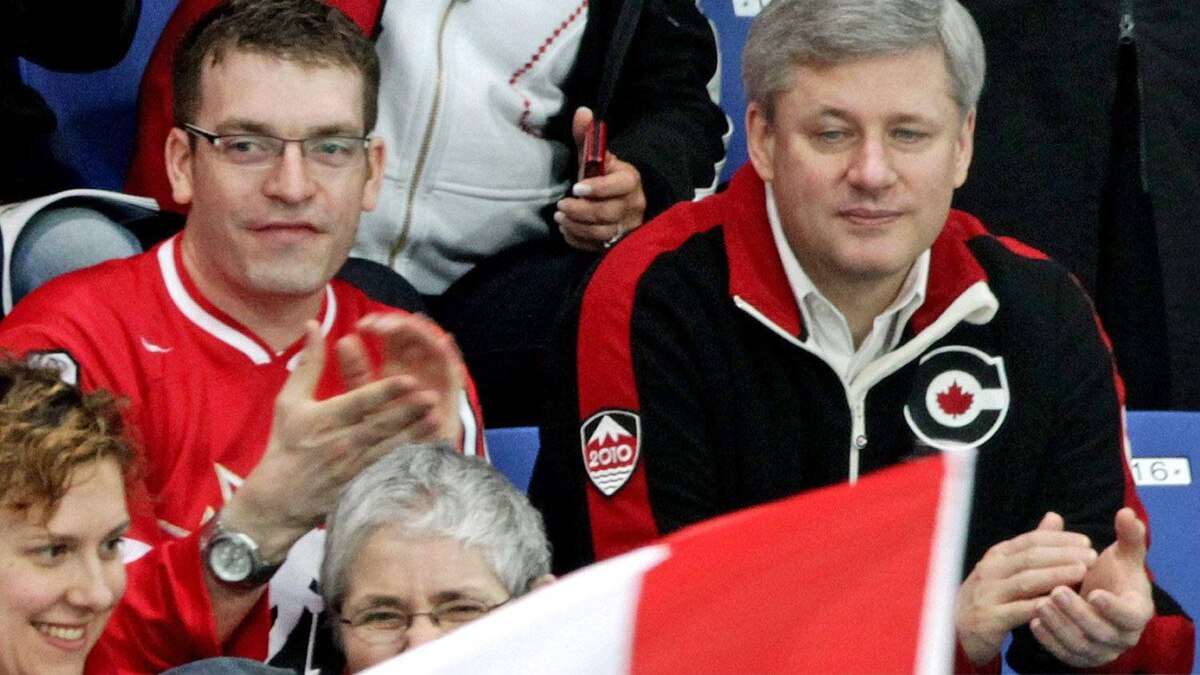Prime Minister Stephen Harper takes in Canada's ice sledge hockey match against Italy during the 2010 Winter Paralympics in Vancouver on March 13, 2010.
