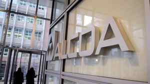 PITTSBURGH, PA - JANUARY 7: Alcoa employees leave Alcoa corporate headquarters January 7, 2009 in Pittsburgh, Pennsylvania.