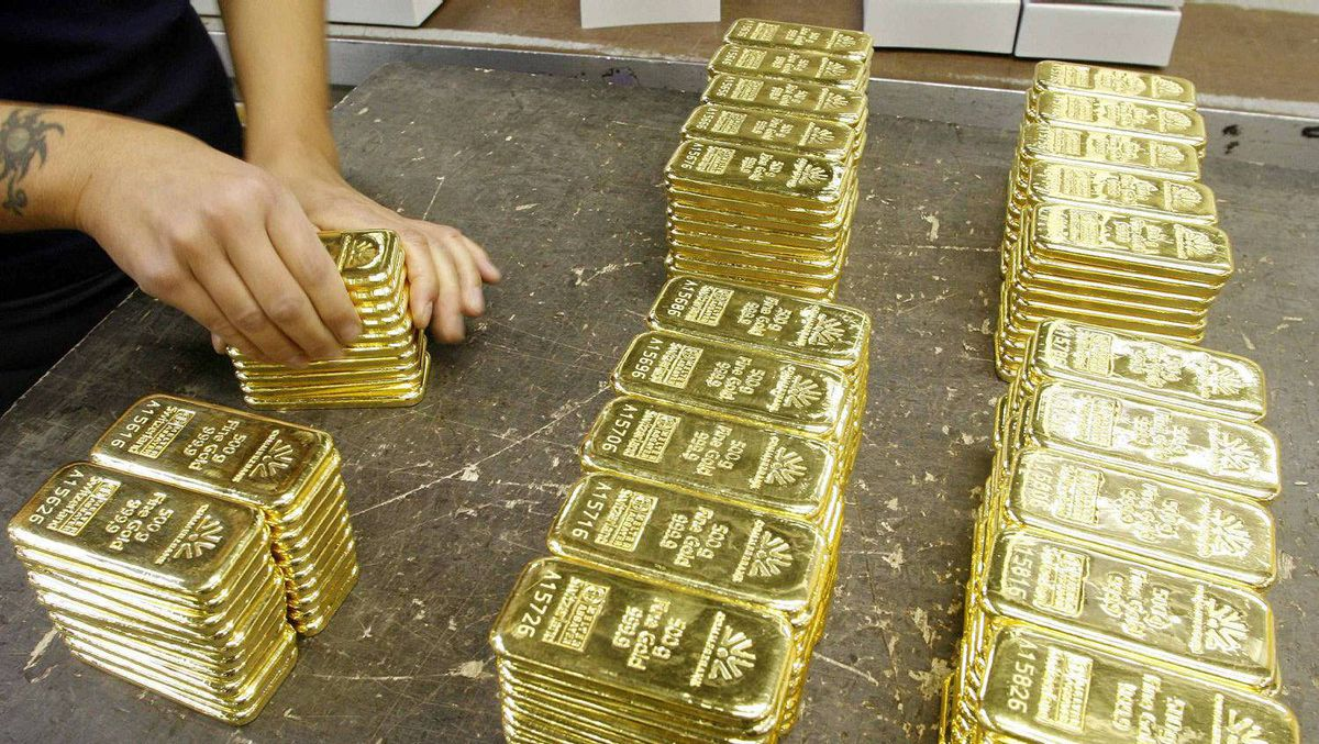 File photo of an employee preparing gold bars for transport at a plant of gold refiner and bar manufacturer Argor-Heraeus SA in the southern Swiss town of Mendrisio.)