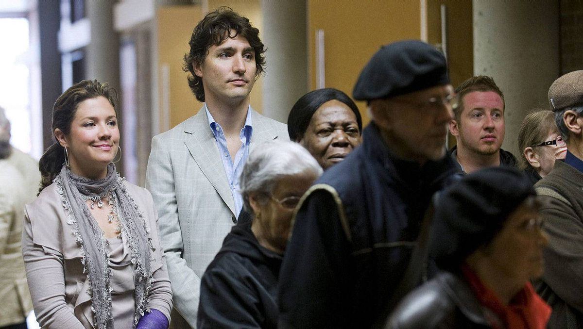 Justin Trudeau, Liberal candidate for the riding of Papineau stands next to his wife Sophie Gregoire, left, as he waits in line to cast his vote in Canada's federal election in Montreal, Monday, May 2, 2011.
