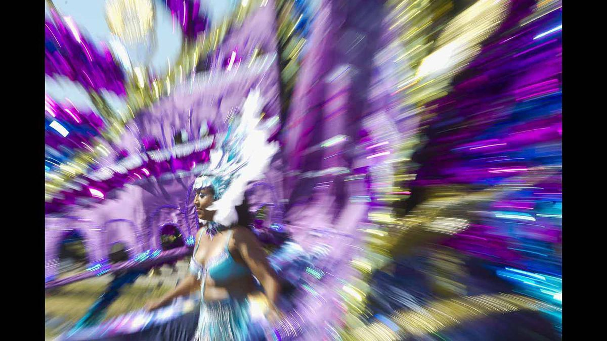 A dancer takes part in the brightly coloured Caribbean Carnival parade.