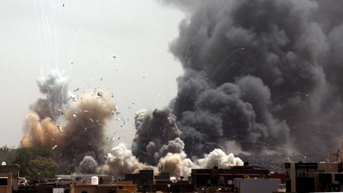 Smoke billows from the site of an explosion across an area in which strongman Moammar Gadhafi has his residence, in Tripoli on June 7, 2011. The complex that includes his residence has been consistently targeted by a NATO air campaign in Libya.