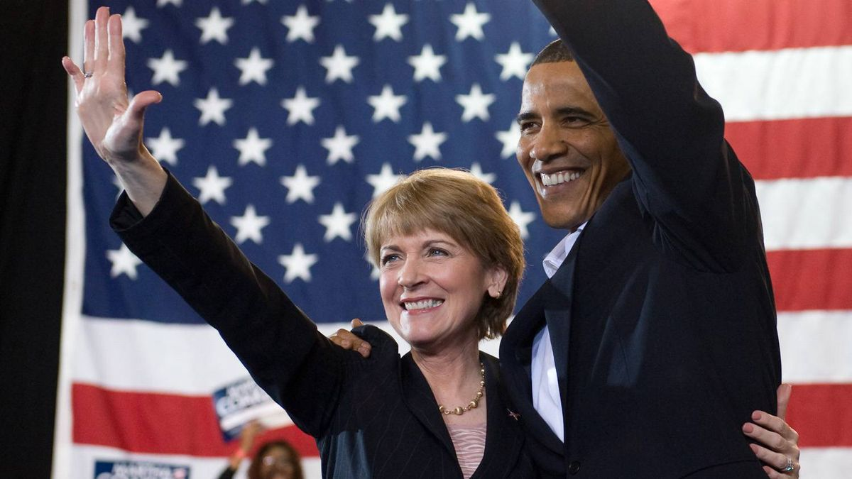 U.S. President Barack Obama and Massachusetts Senate candidate Martha Coakley wave during a campaign rally at Northeastern University in Boston. Saul Loeb/AFP/Getty Images
