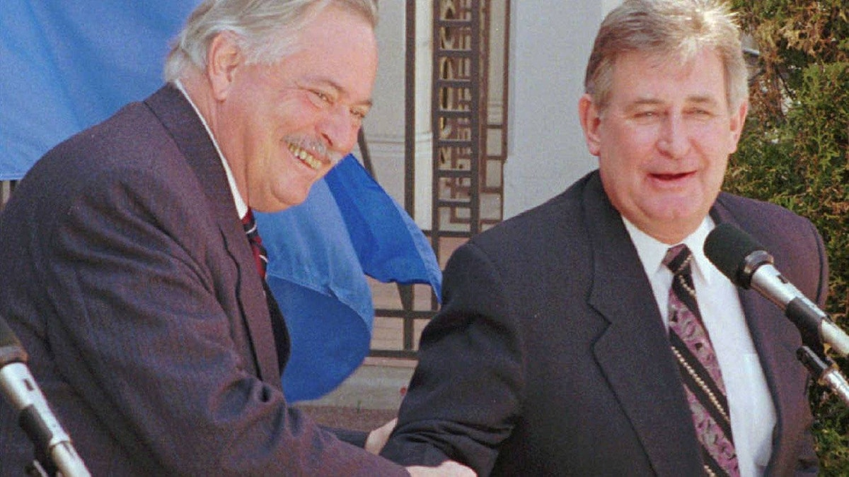 Quebec Premier Jacques Parizeau shakes hands with Mr. Klein at the end of a news conference following a meeting at Premier Parizeau's home in 1995.