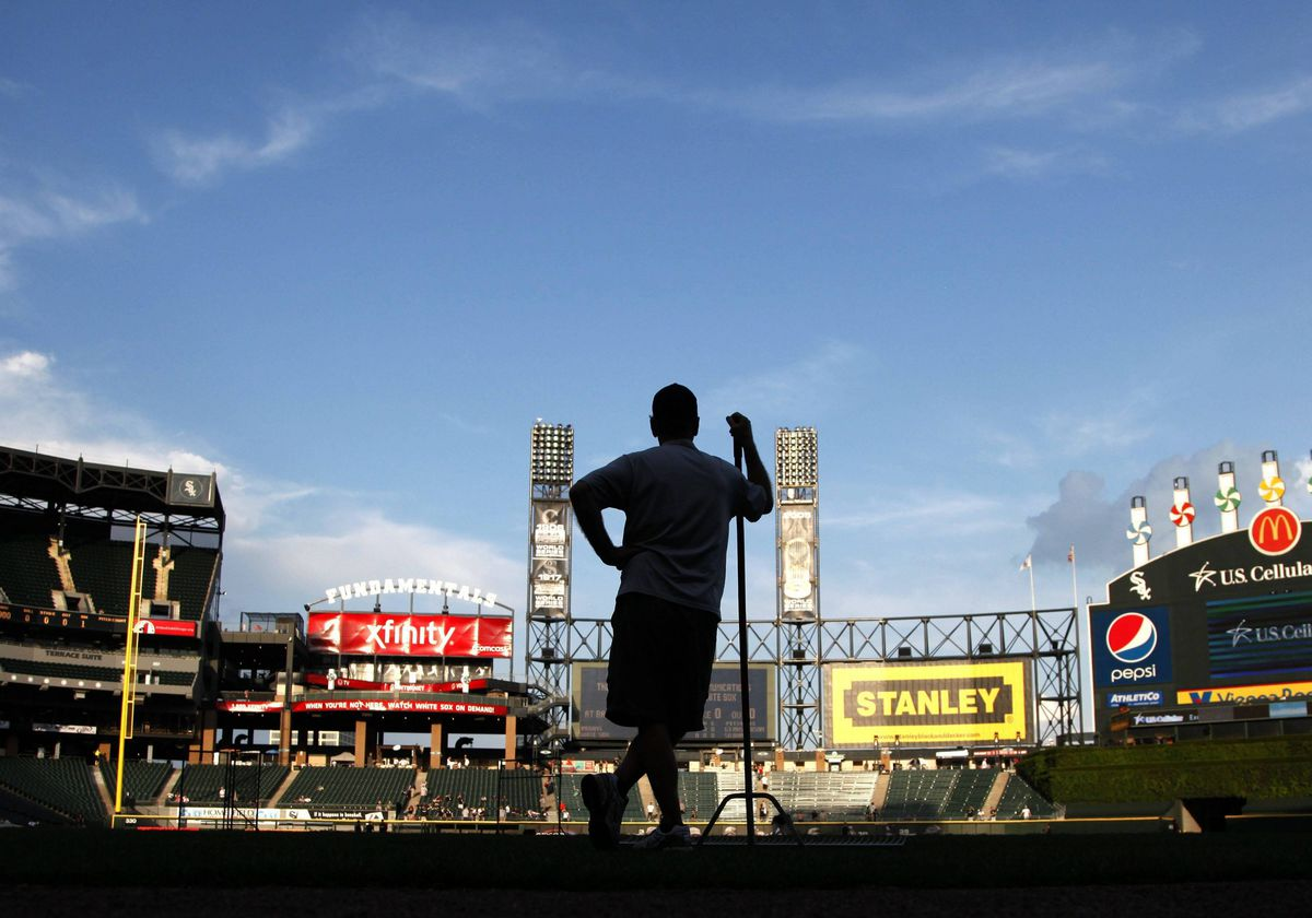 Roger Bossard, Chicago White Sox head groundskeeper at U.S. Cellular Field, waits for batting practice to end before preparing the field for a baseball game between the White Sox and the Cleveland Indians.