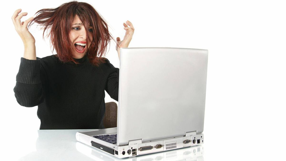 Frustrated woman at a computer.