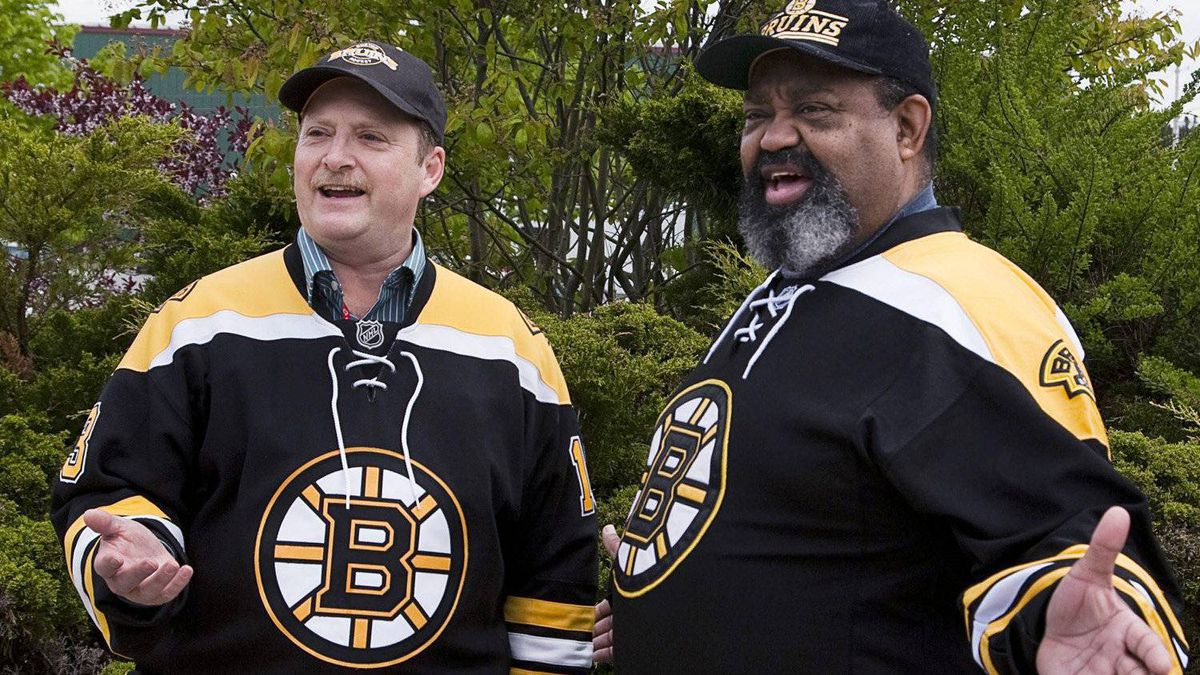 Hockey fans Cecil Wright, right, and his friend Marc Cayouette display their support for the Boston Bruins at work in Halifax on Friday, June 3, 2011. The Bruins have a large fan base in the Maritimes, bolstered by family ties and historic north-south loyalties.THE CANADIAN PRESS/Andrew Vaughan