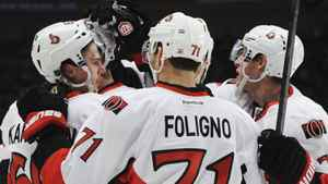 New York Rangers Ottawa Senators Erik Karlsson is congratulated by teammates Nick Foligno (C) and Kyle Turris (R) after he scored a goal against the New York Rangers during the second period of Game 2 of their NHL Eastern Conference quarter-final playoff hockey game at Madison Square Garden in New York April 14, 2012. REUTERS/Ray Stubblebine