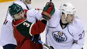 Edmonton Oilers' Dustin Penner, right, keeps Minnesota Wild's Marek Zidlicky, of the Czech Republic, at bay during the first period of an NHL hockey game Tuesday, Feb. 22, 2011, in St. Paul, Minn. The Wild won 4-1. (AP Photo/Jim Mone)