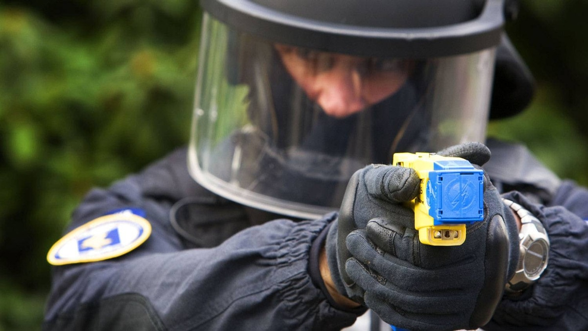 A policeman conducts a demonstration of a Taser electroshock weapon in The Netherlands on March 27, 2009.