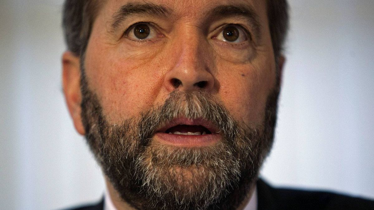 Quebec MP and NDP leadership contender Thomas Mulcair speaks to reporters in Vancouver on Jan. 11, 2012.