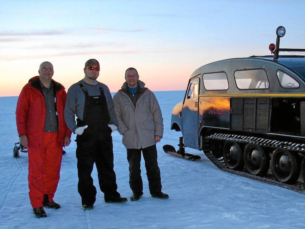 Ron Shewchuck, guide André Chadot and Rocco Chiancio rode in the vintage Bombardier snow machine across Great Slave Lake.