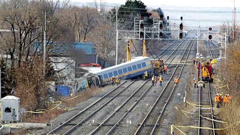 Crews investigate and prepare to remove the wreckage on Feb. 27, 2012, after a VIA train derailed en route from Niagara Falls to Toronto.