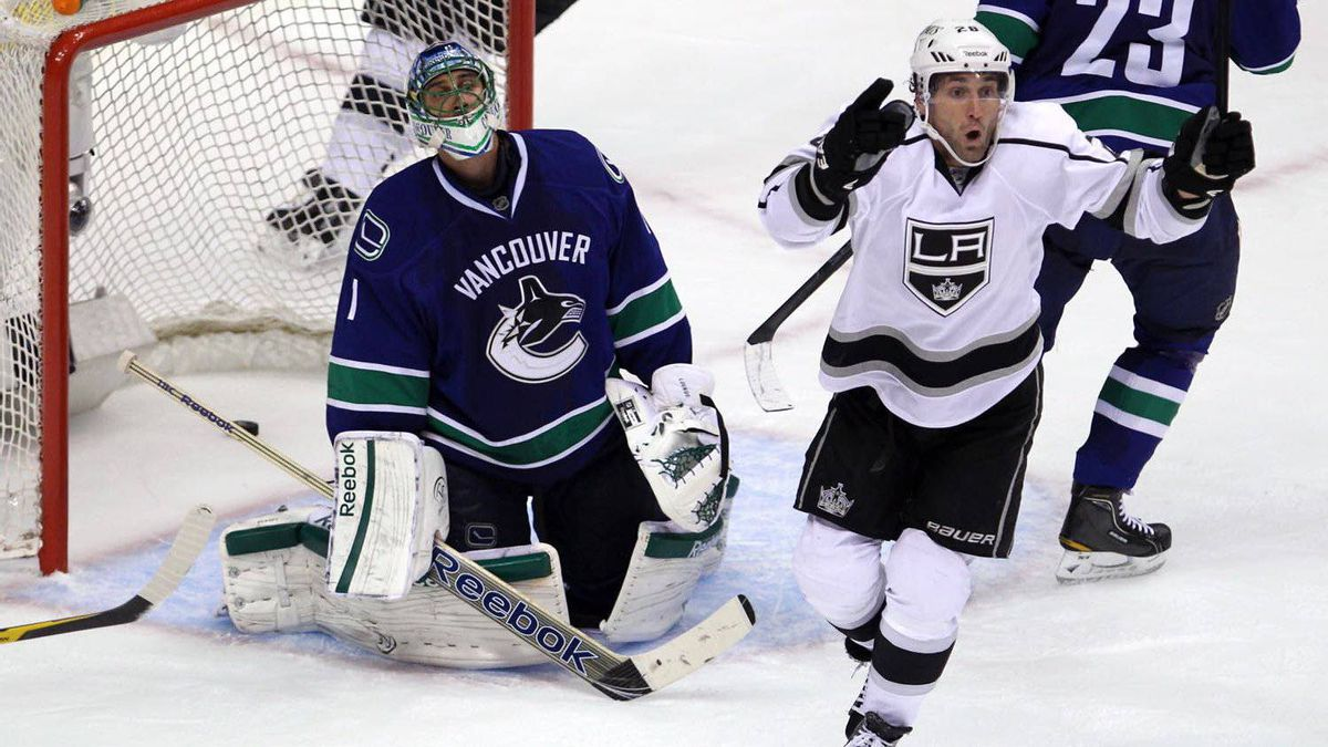 Los Angeles Kings centre Jarret Stoll celebrates Kings defenseman Willie Mitchell's goal past Vancouver Canucks goalie Roberto Luongo during the second period of their NHL Stanley Cup playoff game at Rogers Arena in Vancouver on April, 11, 2012.