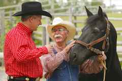 Prime Minister Stephen Harper is greeted by Bill Smith and his horse Nip at Heritage Park before his annual Prime Minister's BBQ during the Calgary Stampede on Saturday.
