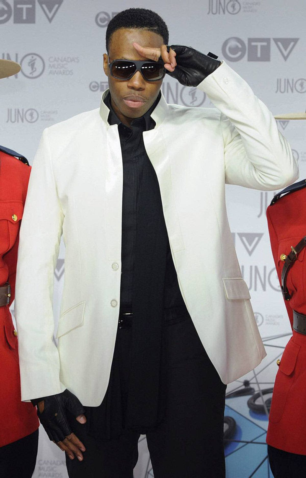 Kardinal Offishal (Jason D. Harrow) poses for photographers as he arrives on the red carpet at the Juno Awards in Ottawa, Sunday April 1, 2012.