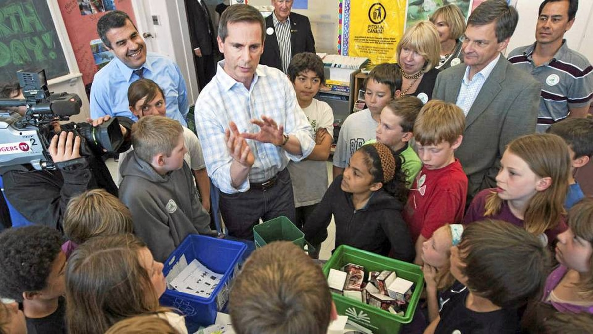 Ontario Premier Dalton McGuinty participates in Earth Day events at the Tecumseh Public School in London, Ont., yesterday.