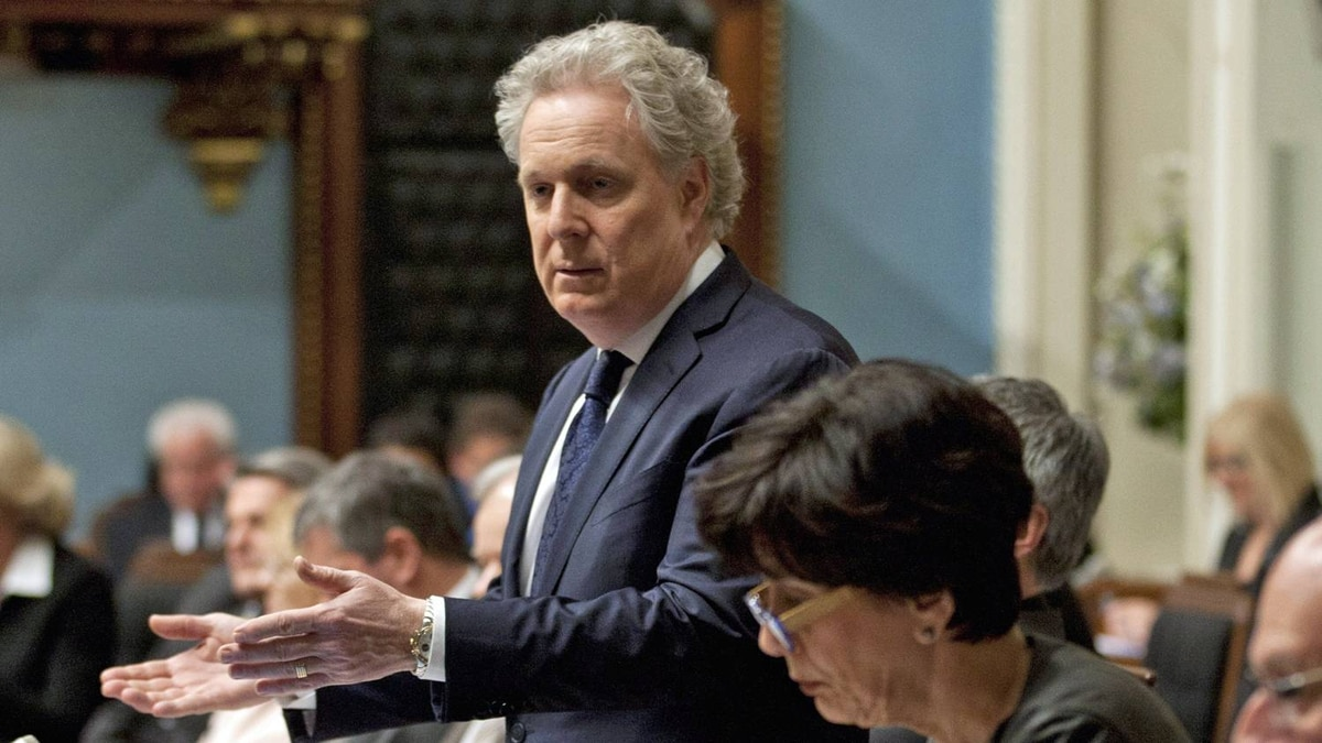 Quebec Premier Jean Charest responds to Oppositoin questions on an expected emergency law on tuition hikes as Education Minister Michelle Courchesne, sits nearby during Question Period on May 17, 2012 at the legislature in Quebec City.