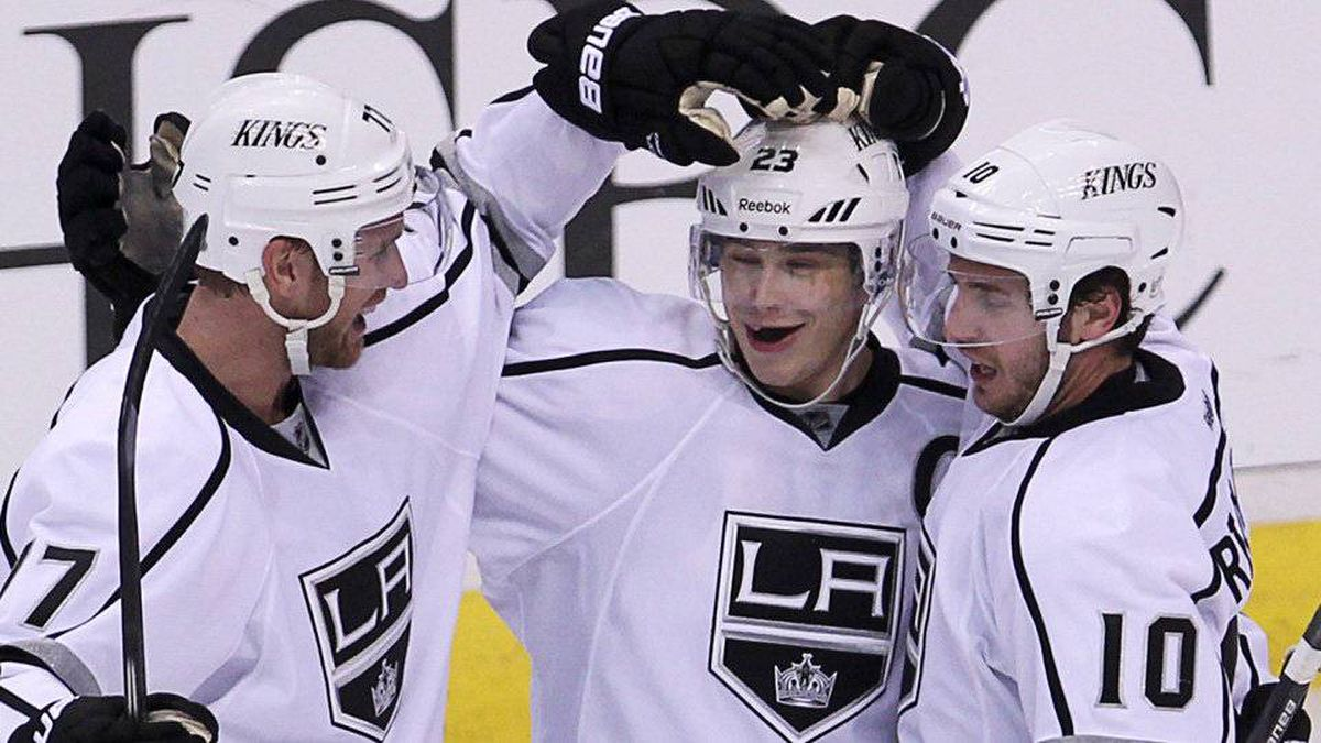 Los Angeles Kings right wing Dustin Brown (23) celebrates his goal against the Vancouver Canucks with teammates Jeff Carter (77) and Mike Richards (10) during third period NHL Stanley Cup playoff hockey action at Rogers Arena in Vancouver, B.C. Wednesday.