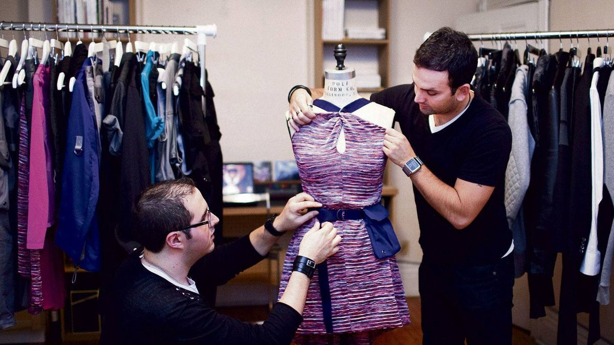 A Diego Fuchs (left) and Helder Aguiar of the nascent label [blak]-i work on a dress in their second collection, which they hope will be more successful than their inaugural line.